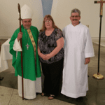 Candy and Jay Krueger after the ceremony with Bishop Salazar