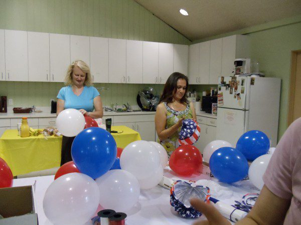 Great Holy Family Volunteers help with Festival of balloons
