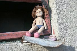 doll in window