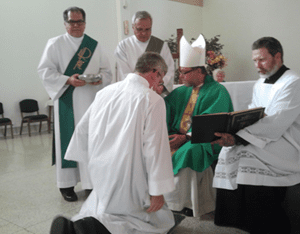 Jay Krueger receiving the Right of Acolyte