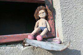 doll in window